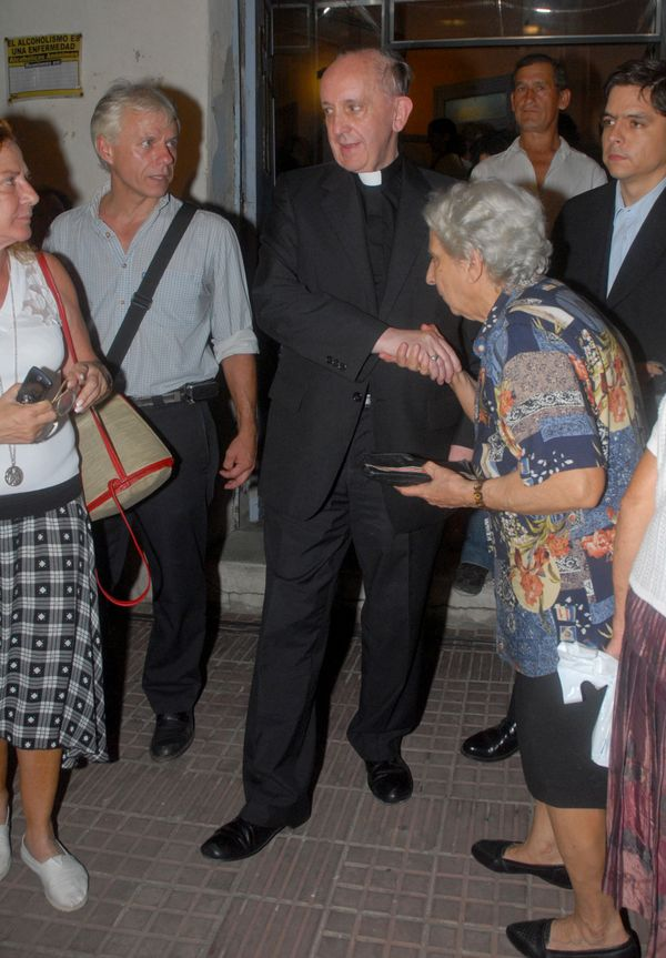 In this photo taken on March 20, 2008, Argentine cardinal Jorge Mario Bergoglio, in the center, shakes the hand of a woman in
