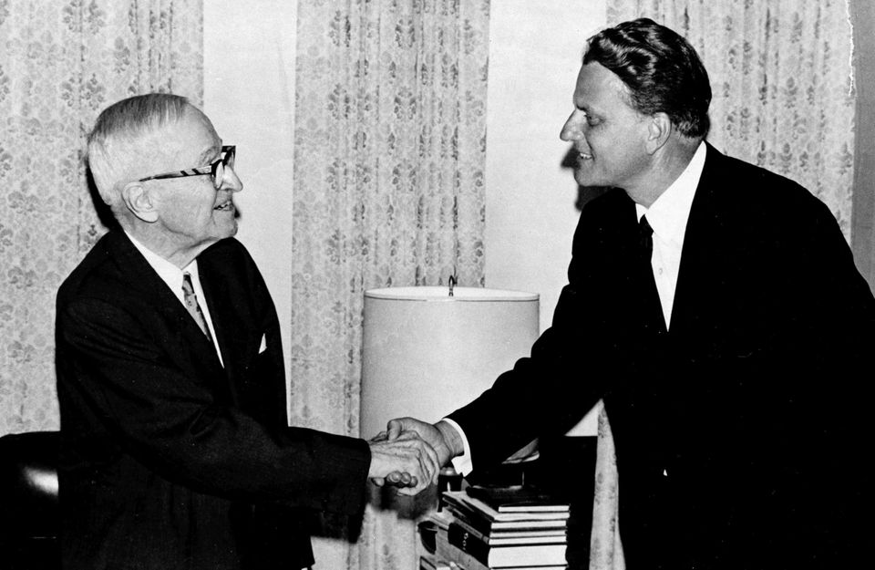 Evangelist Billy Graham, right, pays a 20-minute call on former President Harry Truman at Truman's home in Independence, Mo.,