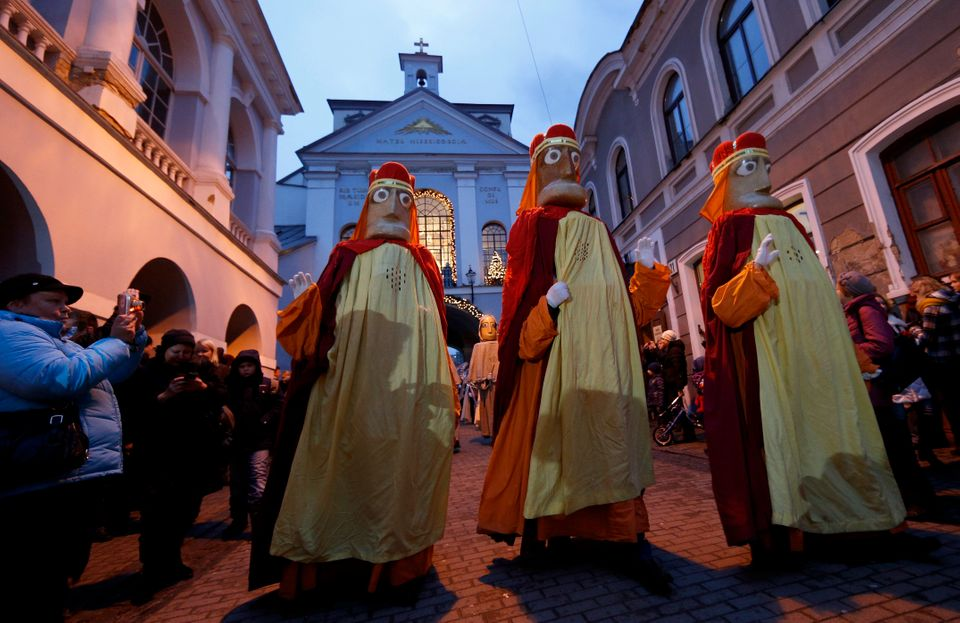 Lithuanians dressed as the Three Kings, parade through the streets, during the Epiphany Day celebrations in downtown Vilnius,