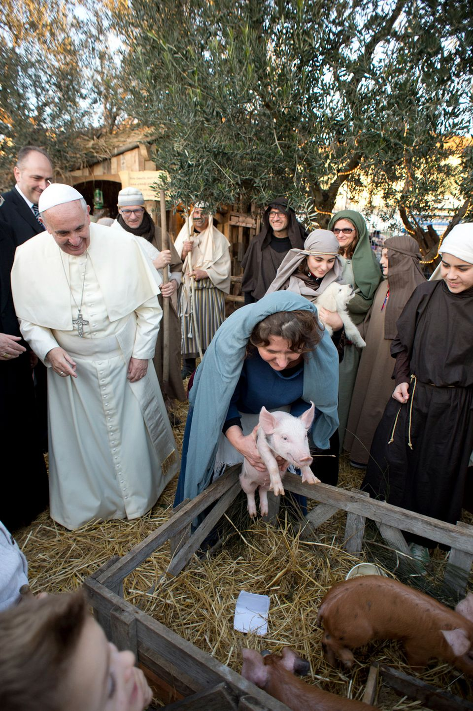 In this photo provided by the Vatican paper L'Osservatore Romano, Pope Francis visits a living nativity scene staged at the S