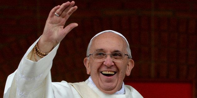 Pope Francis waves to the crowd gathering outside the Basilica of Our Lady of Aparecida, Brazil's most revered Catholic shrin