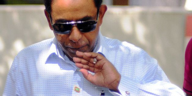 In this photograph taken on November 16, 2013, Maldivian presidential candidate Abdulla Yameen blows on his finger marked wit