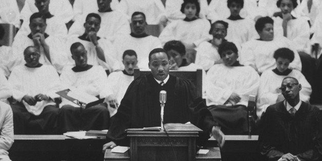 Rev. Martin Luther King Jr. (L) preaching in his church.  (Photo by Donald Uhrbrock//Time Life Pictures/Getty Images)