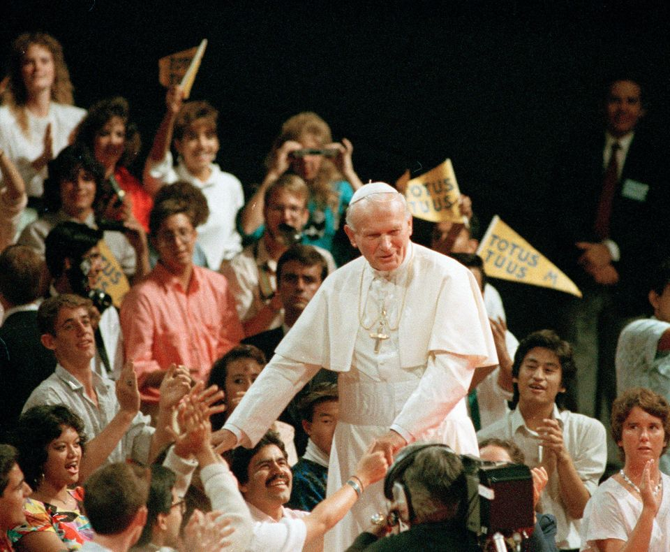 FILE - In a Sept. 15, 1987 file photo, Pope John Paul II walks among young people at the Universal Amphitheatre in Los Angele