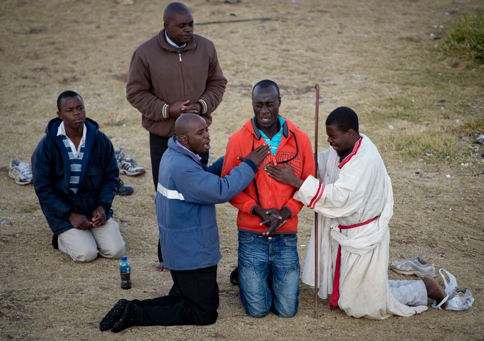 Worshippers from a Baptist church perform exorcism on a congregation member in the Hillbrow neighbourhood overlooking down to