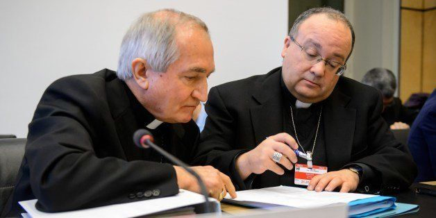 Vatican's UN Ambassador Monsignor Silvano Tomasi (L) speaks with Former Vatican Chief Prosecutor of Clerical Sexual Abuse Cha