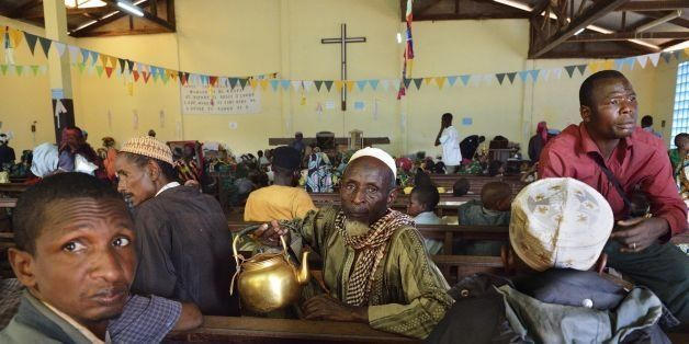 Muslim men take shelter at the Boali church, on January 19, 2014, in Boali, some 100km north of Bangui. Fresh fighting broke