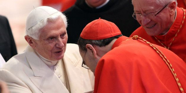 VATICAN CITY, VATICAN - FEBRUARY 22:  Pope Emeritus Benedict XVI greets cardinals as he leaves the St Peter's Basilica at the