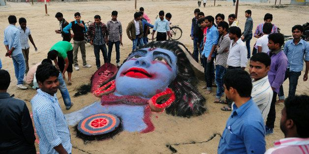 A sand sculpture of Hindu god Lord Shiva, made by Allahabad University students, is pictured on the eve of Maha Shivaratri fe