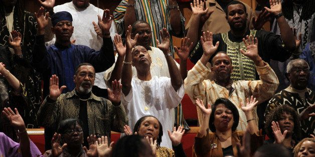 A large choir sings as the Rev. Otis Moss III, senior pastor at Trinity United Church of Christ, leads the service, January 1