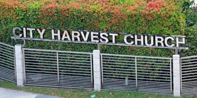 A cyclist rides past the City Harvest Church in Singapore on June 26, 2012.  The founder of one of Singapore's richest church