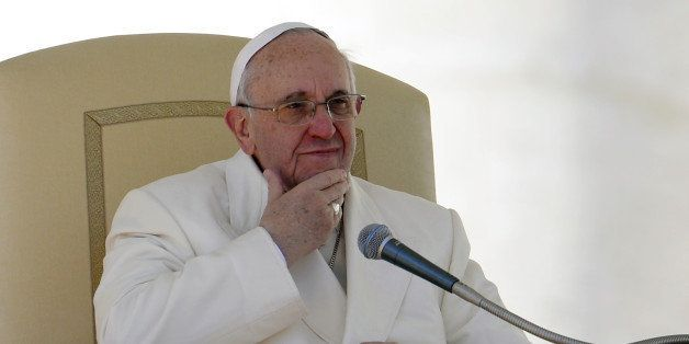 Pope Francis gestures in St.Peter's square at the Vatican during his weekly general audience on March 5, 2014. Pope Francis h