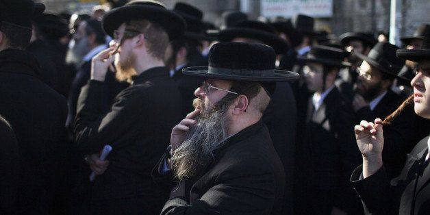 JERUSALEM, ISRAEL - FEBRUARY 12:  Ultra Orthodox men pray during protest against construction at site in the town of Bet-Shem