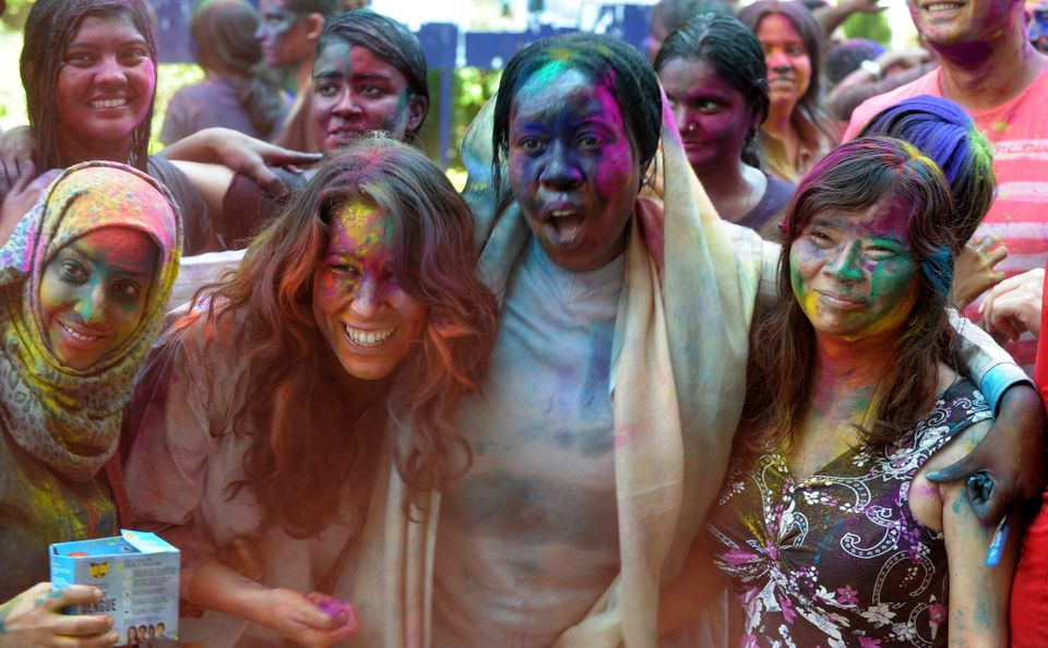 Students of English and Foreign Languages University(EFL)pose during Holi celebrations in Hyderabad on March 17, 2014. Holi,