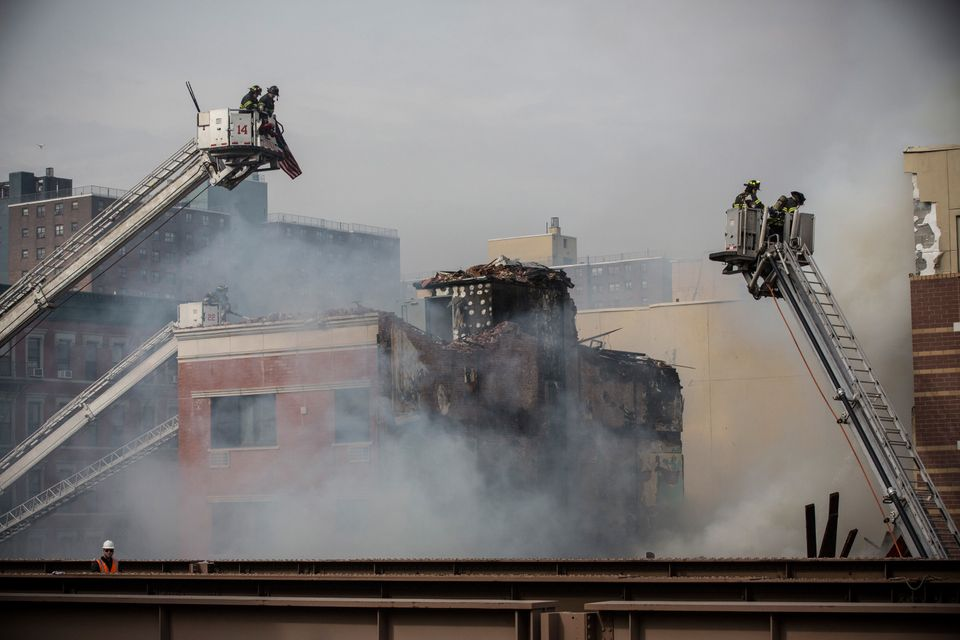 NEW YORK, NY - MARCH 12:  Firefighters from the Fire Department of New York (FDNY) respond to a 5-alarm fire and building col