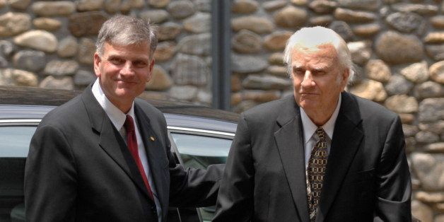 Franklin Graham, left, escorts his father Billy Graham prior to the funeral for their beloved Ruth Graham at Anderson Auditor
