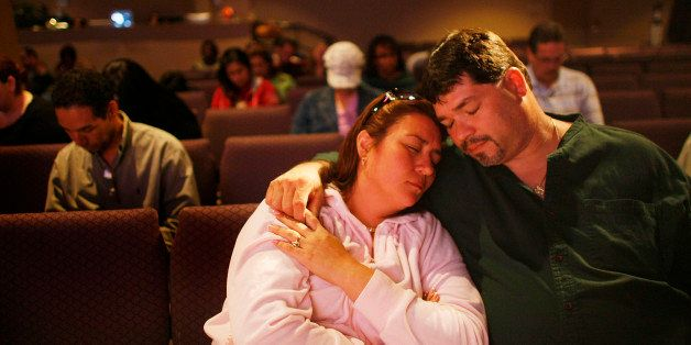 KENDALL, FL - MARCH 07:  Priscilla Mendez and Tony Mendez pray together as Kevin Cross delivers a sermon about faith-based fi