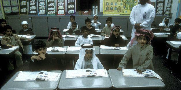 AL HUFUF, SAUDI ARABIA - JANUARY, 2003:  Pupils work in class at The Prince Mohammed Bin Fahad Bin Abdulaziz School in the ci
