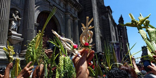 Catholics take part in the traditional Palm Sunday procession by the Cathedral in Mexico City on March 24, 2013. Palm Sunday