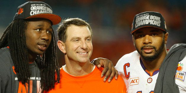 MIAMI GARDENS, FL - JANUARY 3: (L - R) Sammy Watkins #2, head coach Dabo Swinney, and Tajh Boyd #10 of the Clemson Tigers cel