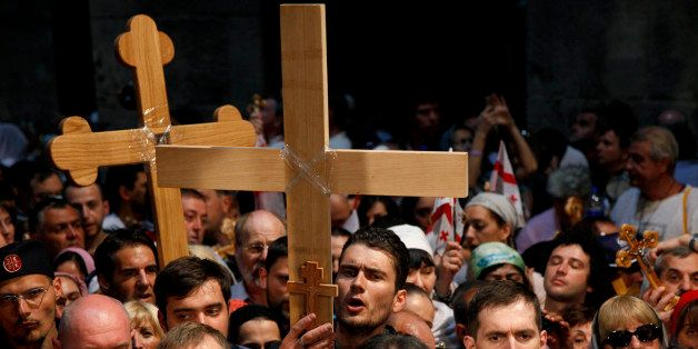 Christian Orthodox pilgrims carry wooden crosses along the Via Dolorosa during a procession marking the Orthodox Good Friday