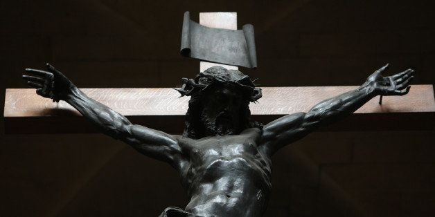 Statue of Christ on the cross. (Photo by: Godong/Universal Images Group via Getty Images)