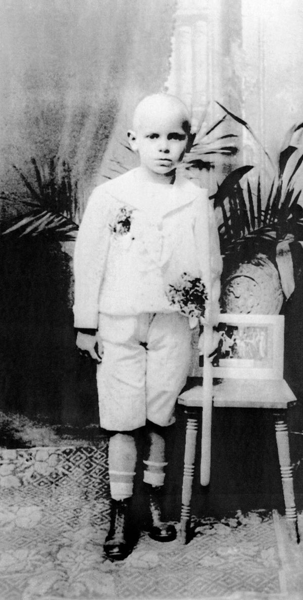 This file photo taken in the 1930s shows Karol Wojtyla posing with a candle in his hand after receiving First Communion at hi
