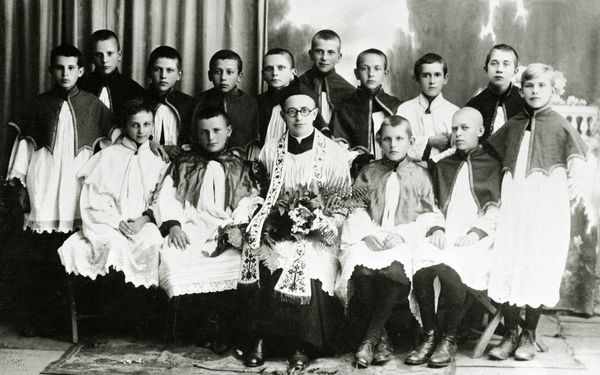 Pope John Paul II (as young Karol Wojtyla, sitting second from left) as an acolyte and the priest Kazimierz Figlewicz are see