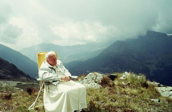 Pope John Paul II takes a break during his Alpine vacation in July 2000 in Val d'Aosta, Italy. (Photo by Arturo Mari-Vatican