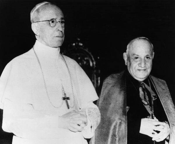Pope Pius XII poses with Cardinal Angelo Giuseppe Roncalli. The latter will succeed him to the papal throne in 1958 under the