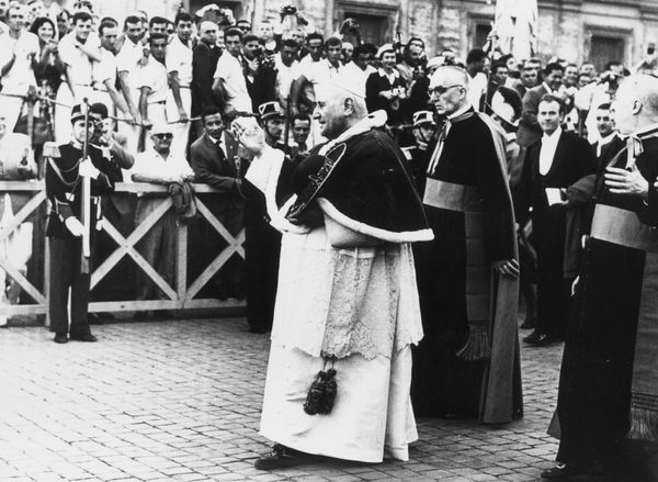 Pope John XXIII (Angelo Giuseppe Roncalli) (1881 - 1963) walking through the crowds in St Peter's Square, at the opening cere