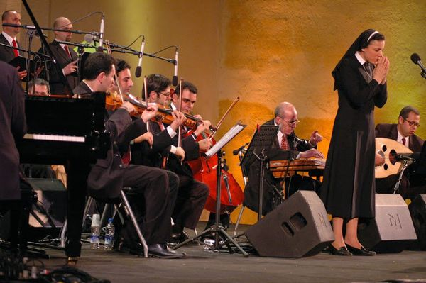 In 2002 The Lebanese Maronite Christian nun Sister Marie Keyrouz performed her devotional songs with a full orchestra to a ra