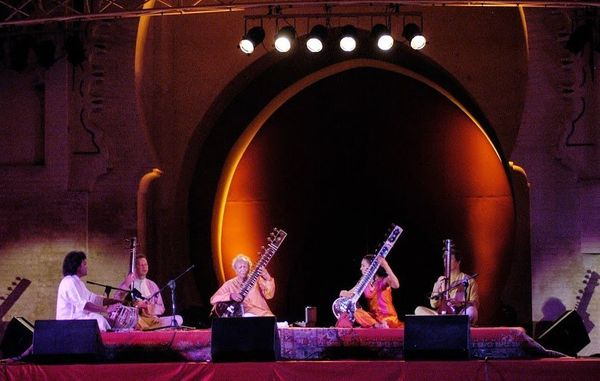 The Bab Makina stage sits in front of a Moorish arch. Lighting designers enjoy devising subtle colour changes that enhance bo