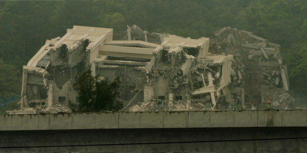 This image taken on April 30, 2014 shows a Christian church in the town of Oubei, outside the city of Wenzhou that Chinese authorities had begun demolishing on April 28, according to Internet postings, after a weeks-long stand-off between worshippers and the local government. Authorities had approved the construction of the Sanjiang Church in Wenzhou with an area of 1,881 square metres (20,240 square feet) but the finished building was roughly four times that size, state media have reported, which the local government claims is an illegal structure. AFP PHOTO/Mark RALSTON (Photo credit should read MARK RALSTON/AFP/Getty Images)
