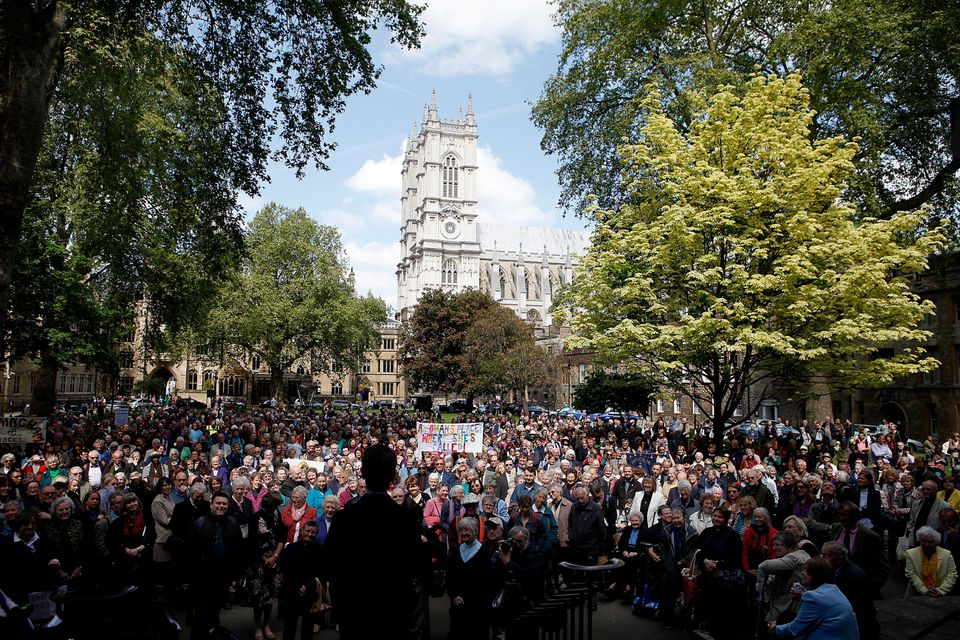 LONDON, ENGLAND - MAY 03: A crowd of over hundreds of women priests listen to speeches at Dean's Yard, Westminster before mar