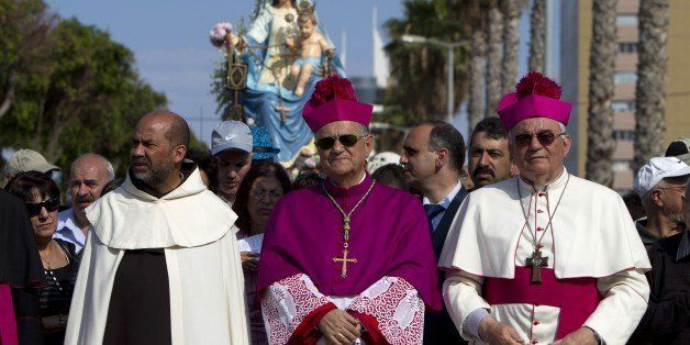 The Latin Patriarch of Jerusalem and Head of the Roman Catholic Church in the Holy Land, Fuad Twal, takes part in a march in
