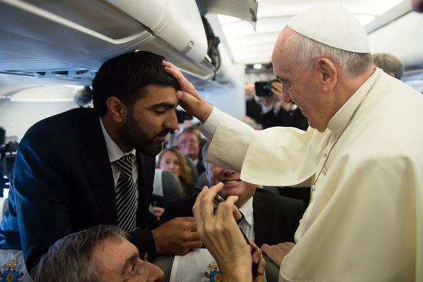 In this photo provided by the Vatican newspaper L'Osservatore Romano, Pope Francis blesses Palestinian reporter Imad Freij ab