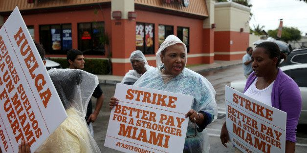MIAMI, FL - MAY 15:  People join in a fast food workers protest in front of a Wendy's restaurant on May 15, 2014 in Miami, Fl