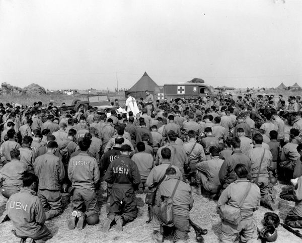 The Seabees of the 111th Naval Construction Battalion give thanks on D-Day plus 12, 18 June 1944. Navy Chaplains have served