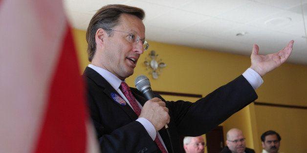 GLEN ALLEN, VA - APRIL 26:  College economics professor and Republican candidate for Congress David Brat (C) addresses voters