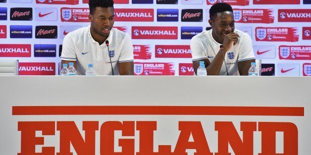 England's forward Daniel Sturridge (L) and England's forward Daniel Welbeck react during a press conference at the Urca milit