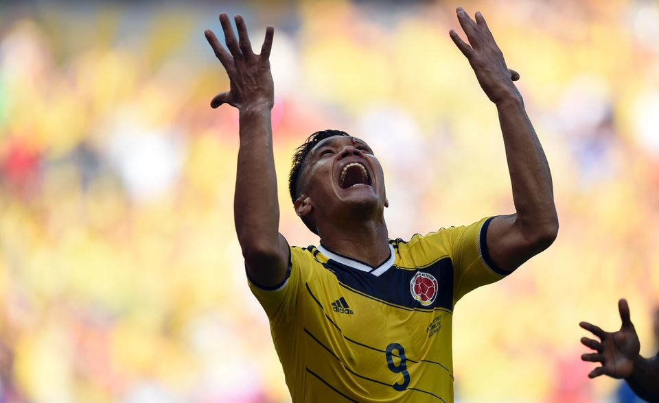 Colombia's forward Teofilo Gutierrez celebrates after scoring during a Group C football match between Colombia and Greece at
