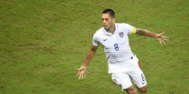 US forward Clint Dempsey celebrates after scoring during a Group G football match between USA and Portugal at the Amazonia Ar