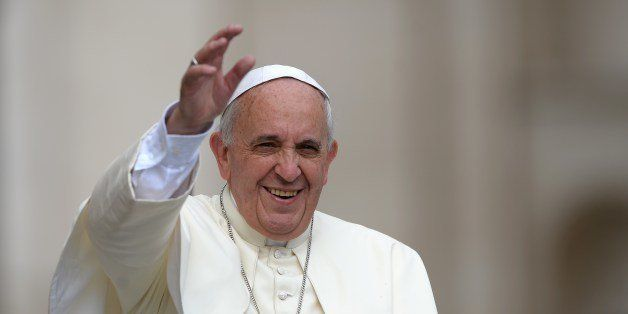 Pope Francis greets the crowd as he arrives for his general audience at St Peter's square on June 25, 2014 at the Vatican.