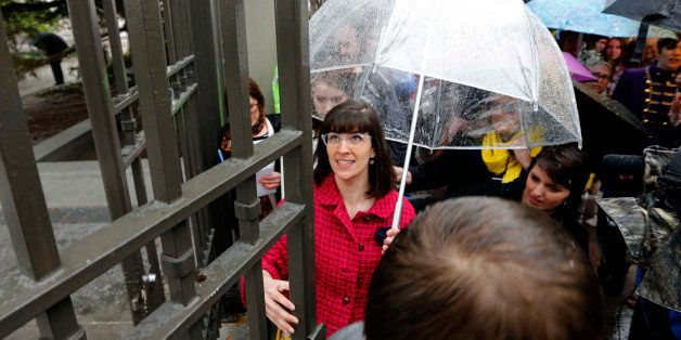 SALT LAKE CITY, UT - APRIL 5: Kate Kelly (C), founder of  'Ordain Women' opens the closed east gates to Temple Square along w