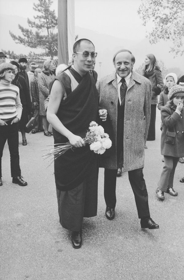 In 1973, the Dalai Lama visited the SOS Children's Village of Hinterbrühl in Austria. In the photo, he stands by Hermann Gmei
