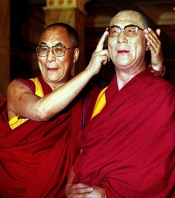 The Dalai Lama poses with his wax portrait in the Grand Hall at Madame Tussaud's in November 1993 in London. The Dalai Lama b