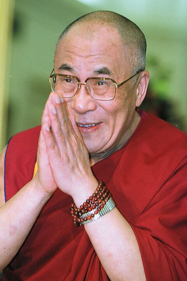 The Dalai Lama greets the media on Capitol Hill before meeting with congressional leaders on June 20, 2000 in Washington.