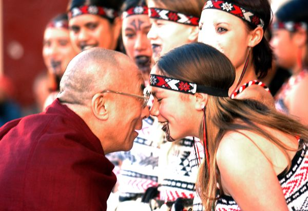 The Dalai Lama takes part in a Hongi, a traditional Māori greeting in New Zealand, on on May 27, 2002.