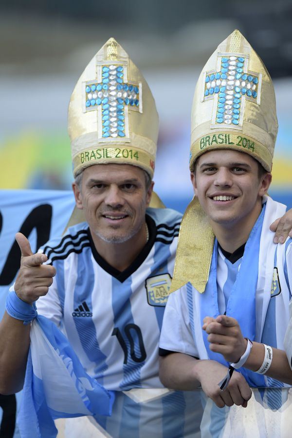 Argentina fans dressed up as Argentinian Pope Francis cheer prior to a Group F football match between Argentina and Iran at t